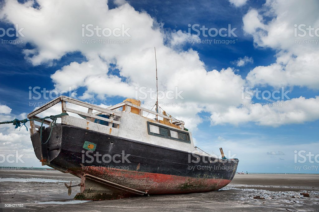 Rundown and Stranded Fisherman's Boat in Jericoacoara, Brazil stock photo