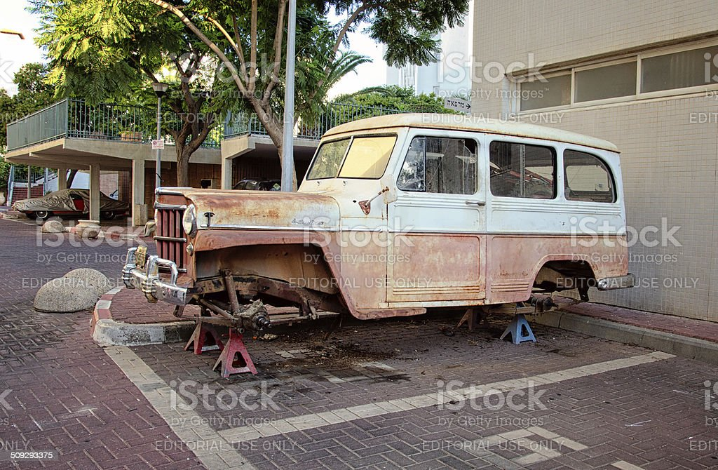Run-down Willys Jeep Station Wagon stock photo