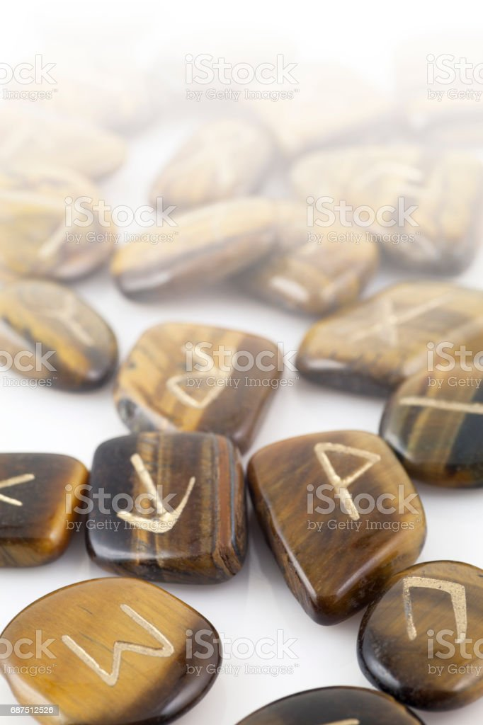 Rune Stones carved in Tiger's Eye stock photo