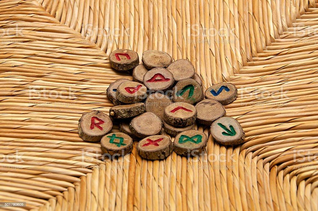 Runes on rattan surface stock photo