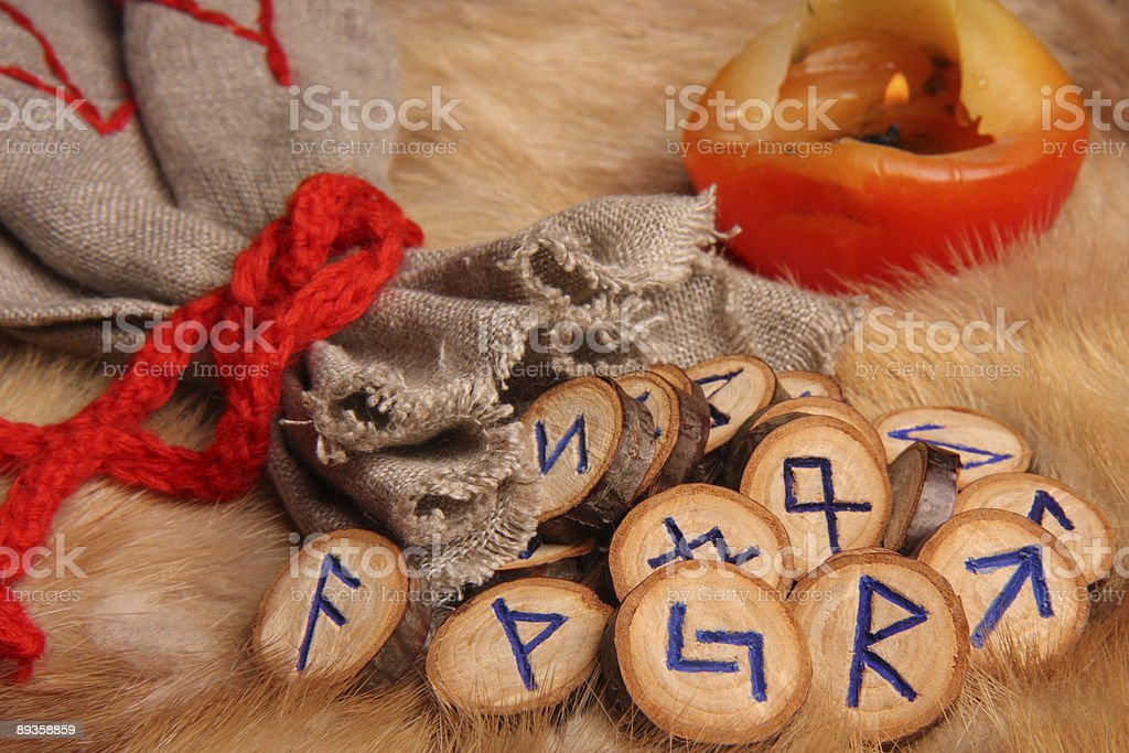 Runes with pouch and candle royalty-free stock photo