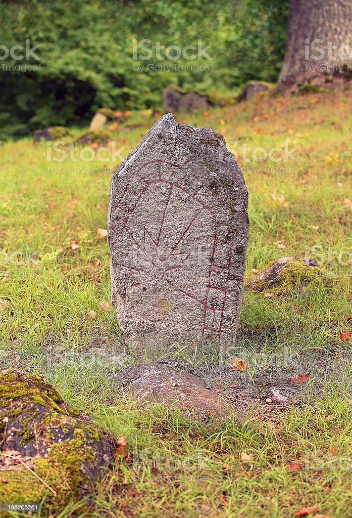 Runestone in a meadow stock photo