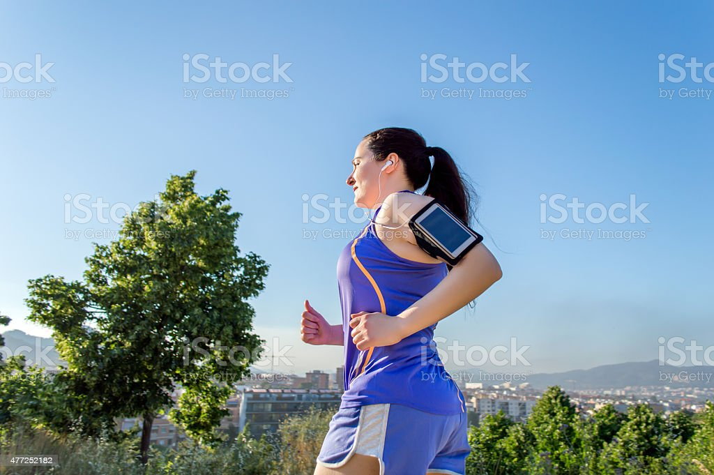 runing with music stock photo