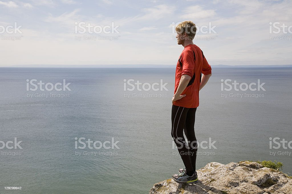 Runner admiring coastal landscape stock photo