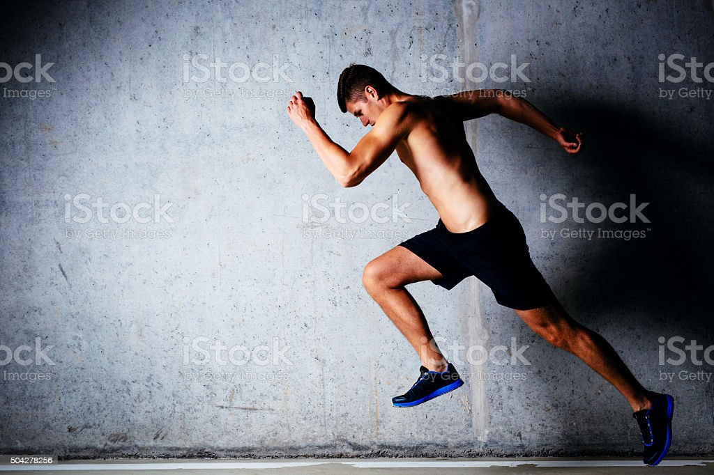 Runner against concrete wall stock photo