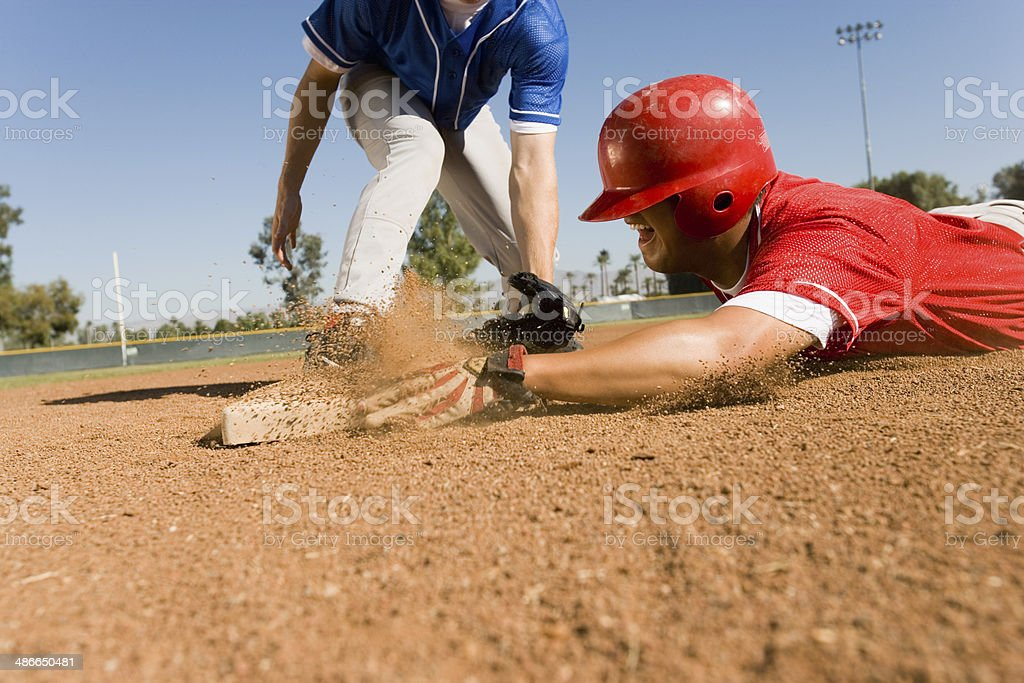 Runner and Infielder Both Reaching Base stock photo
