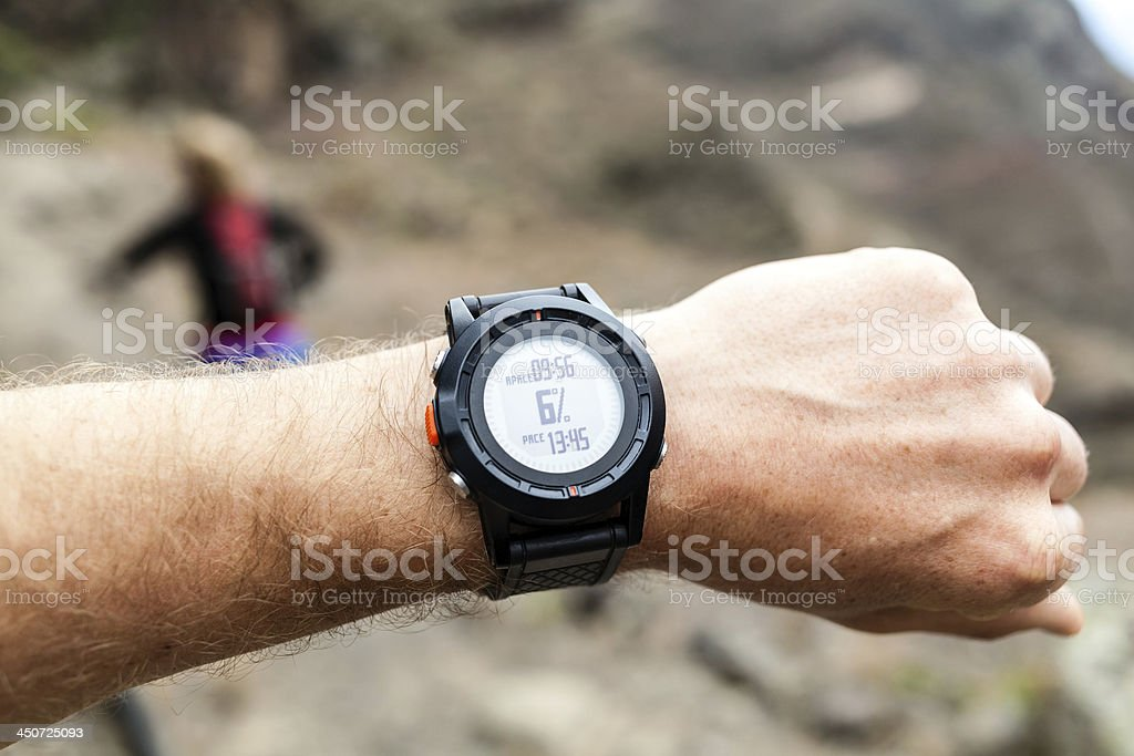 Runner and sport watch in mountains royalty-free stock photo