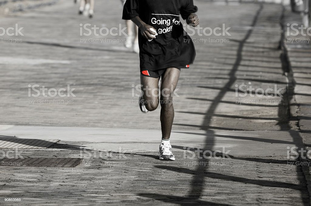 Runner and track shadows stock photo
