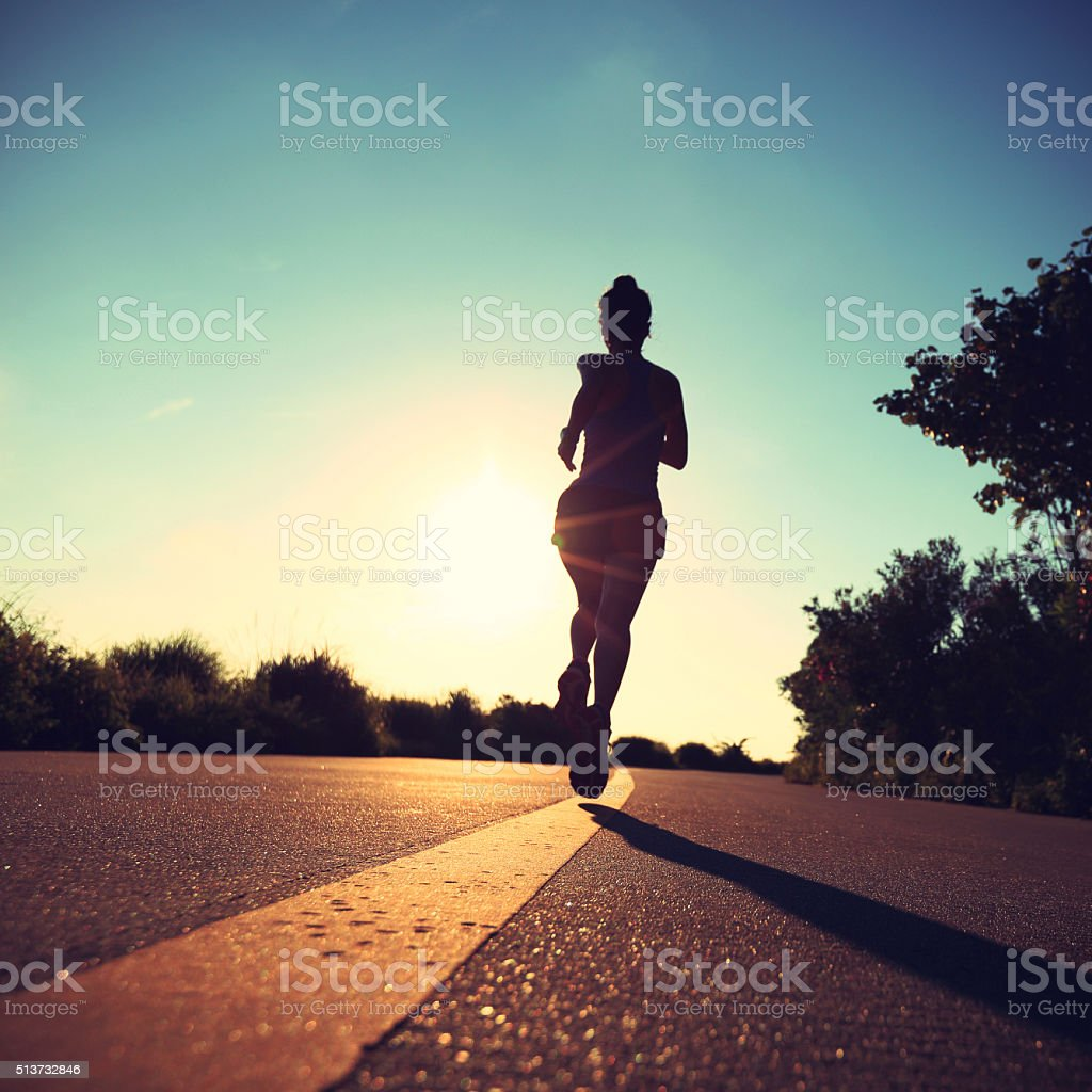 Runner athlete running at seaside road.vintage effect stock photo