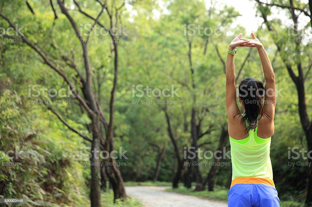 Runner athlete running on forest trail. stock photo