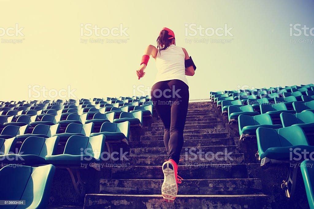 Runner athlete running on stairs. stock photo