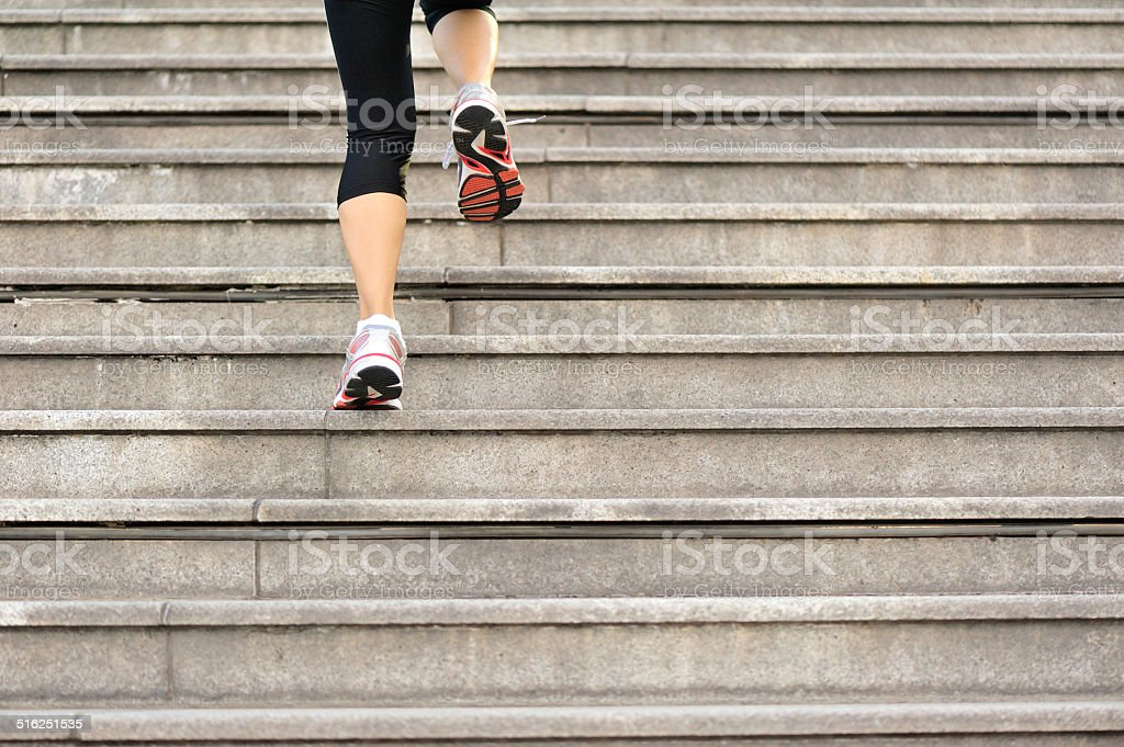 Runner athlete running on stairs. stock photo
