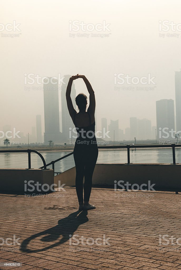 Fit and young athlete woman enjoying exercising in the morning on the...
