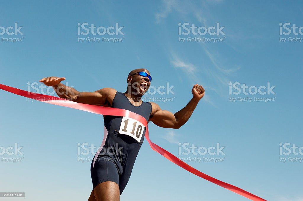 Runner Breaking Finish Line Tape stock photo