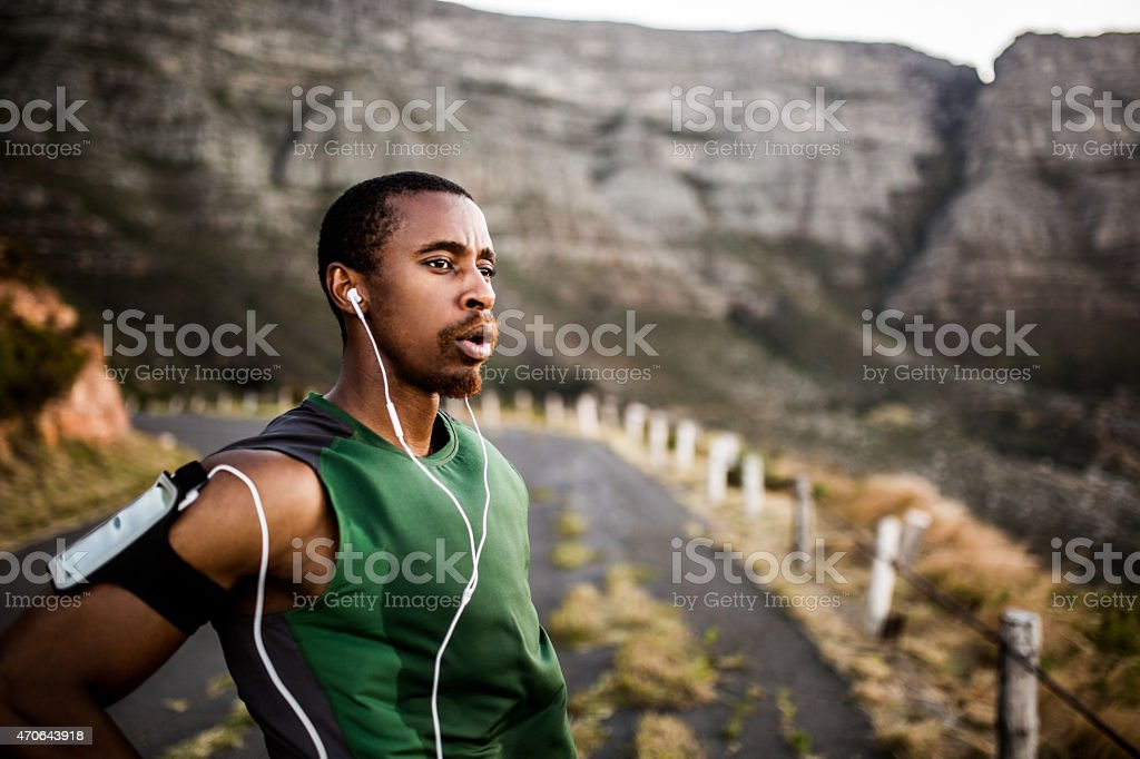 Runner breathing while taking a break from exercise stock photo
