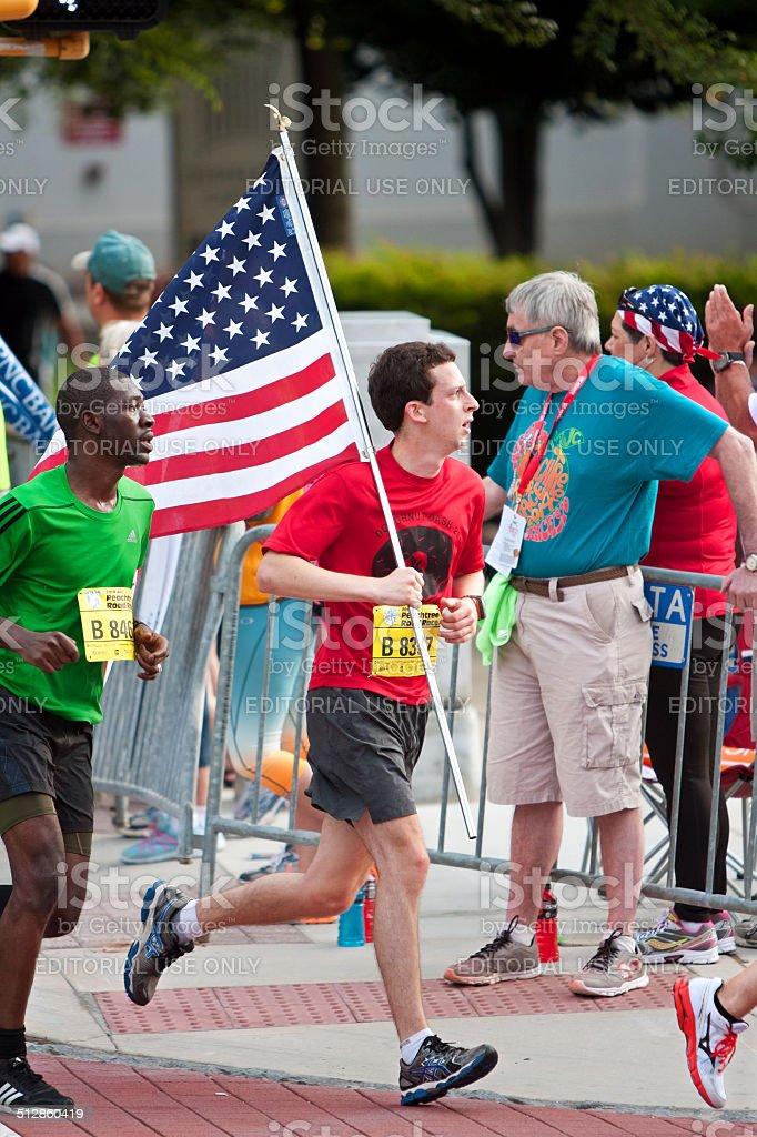 Runner Carries American Flag In July 4 Atlanta Road Race stock photo