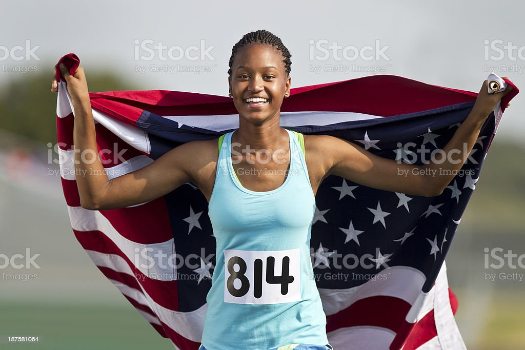 Runner Carrying American Flag During Victory Lap. stock photo