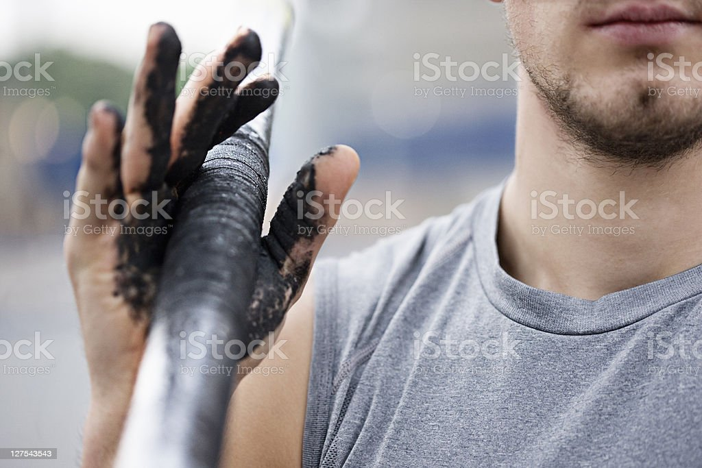 Runner carrying dirty pole  stock photo