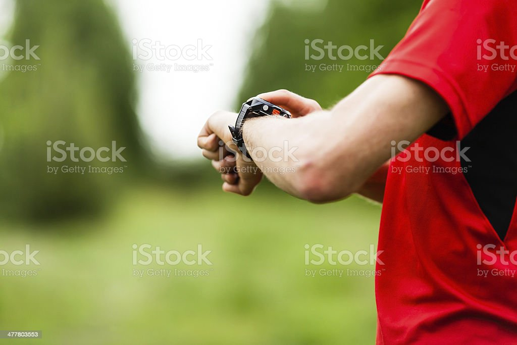 Runner checking GPS royalty-free stock photo