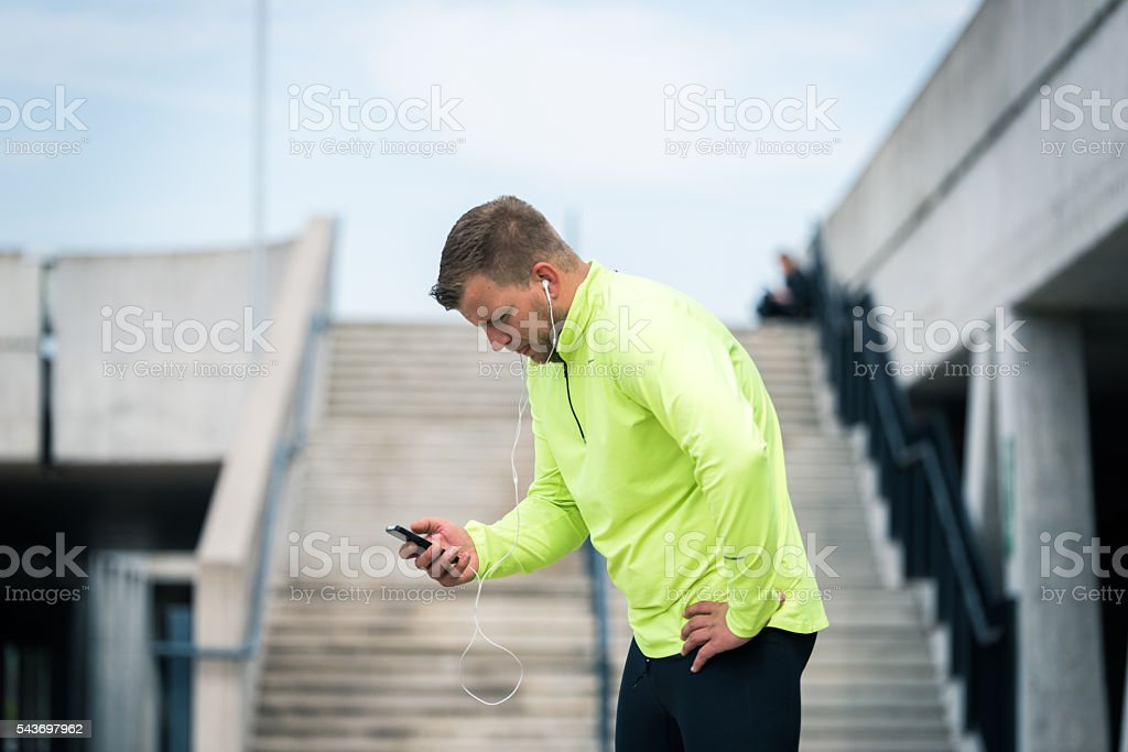 Runner checking results stock photo
