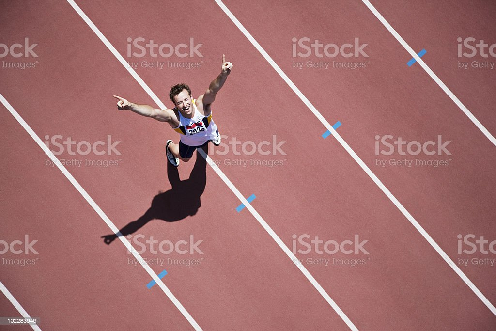 Runner cheering on track royalty-free stock photo