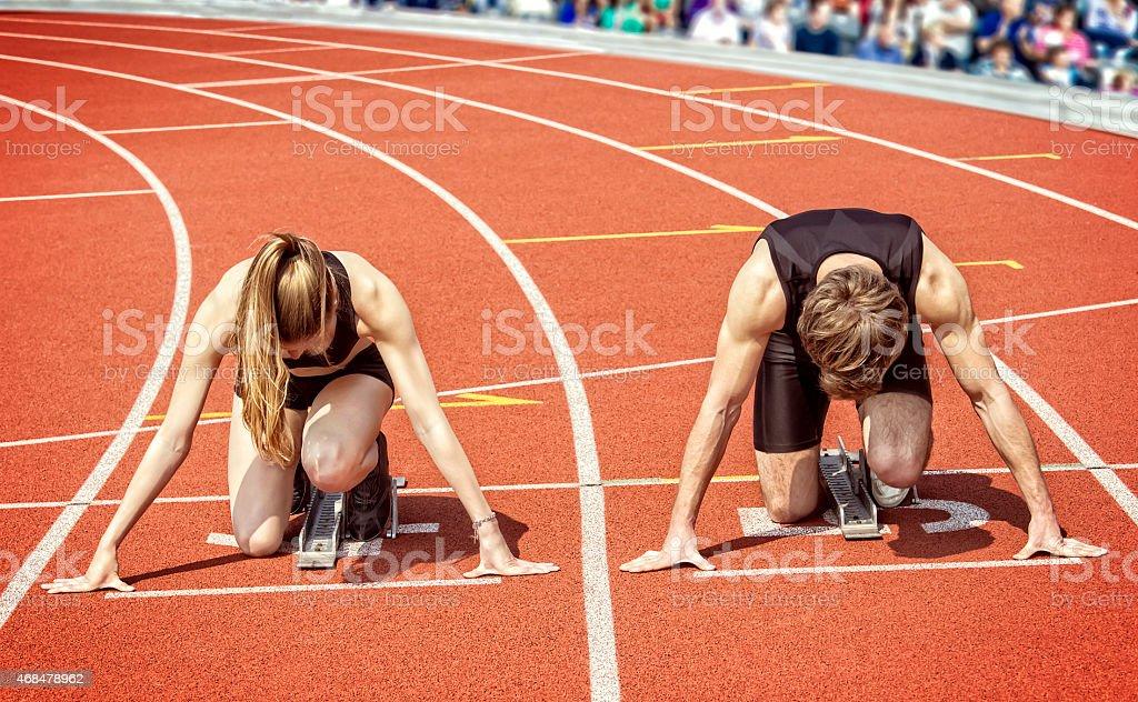 Runner couple  start curve stadium stock photo