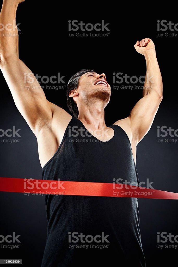 Runner crossing finish line royalty-free stock photo