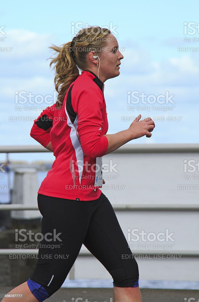 Runner dressed in pink royalty-free stock photo
