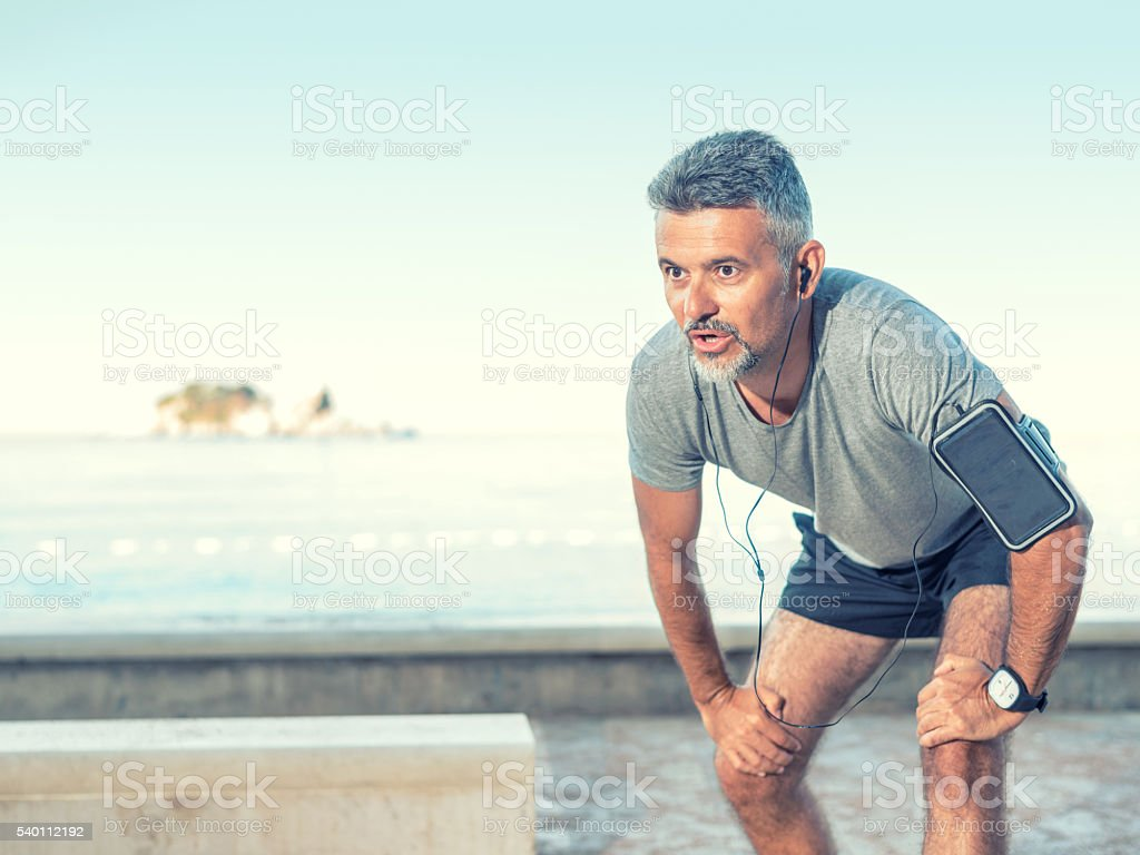 Runner exhausted after jogging stock photo