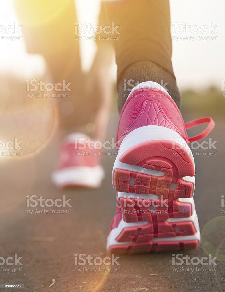 Runner feet running on road royalty-free stock photo
