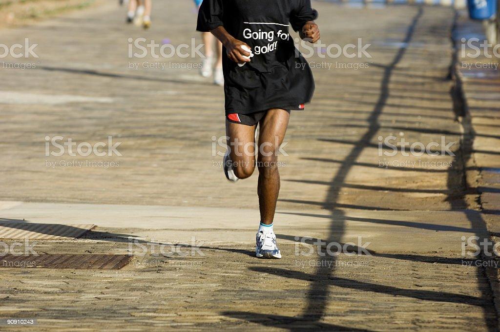 Runner going for gold stock photo
