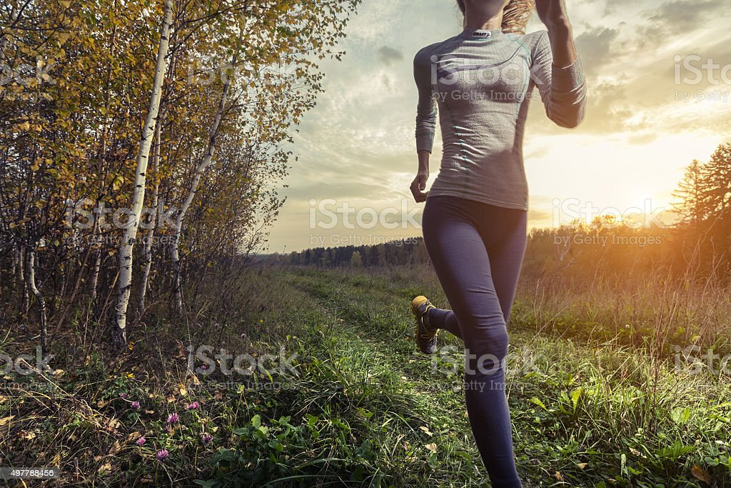 Runner in a forest stock photo