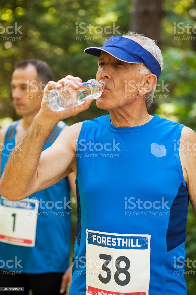 Runner in forest preparing for start of cross country stock photo