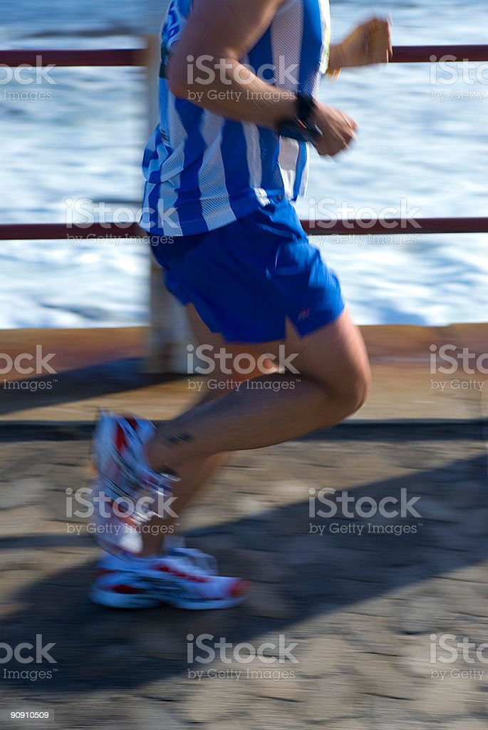 Runner in motion royalty-free stock photo