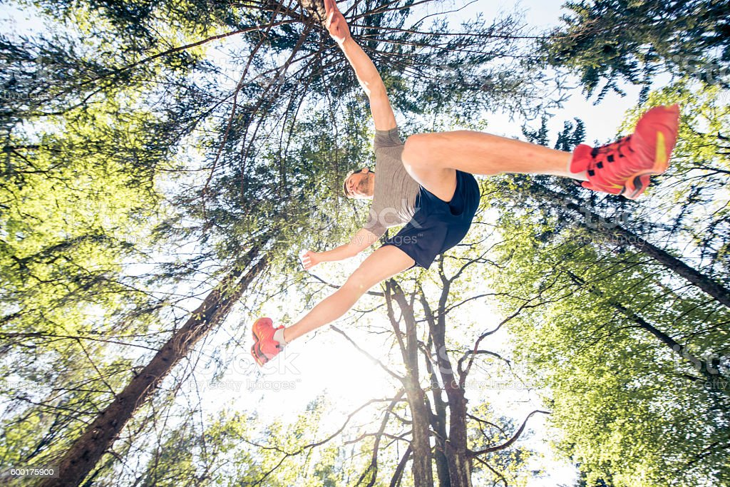 Runner in the air stock photo