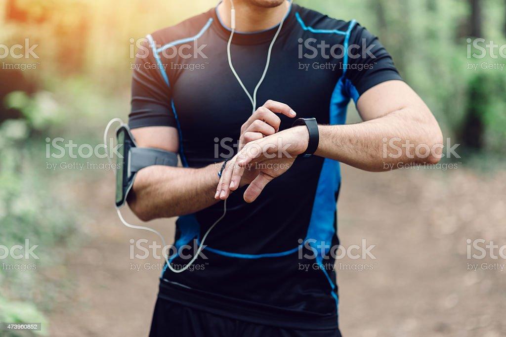 Runner in the park preparing for jogging stock photo