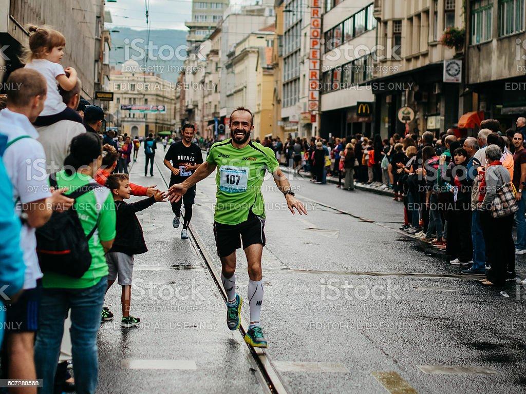 Runner is celebrating the finish stock photo