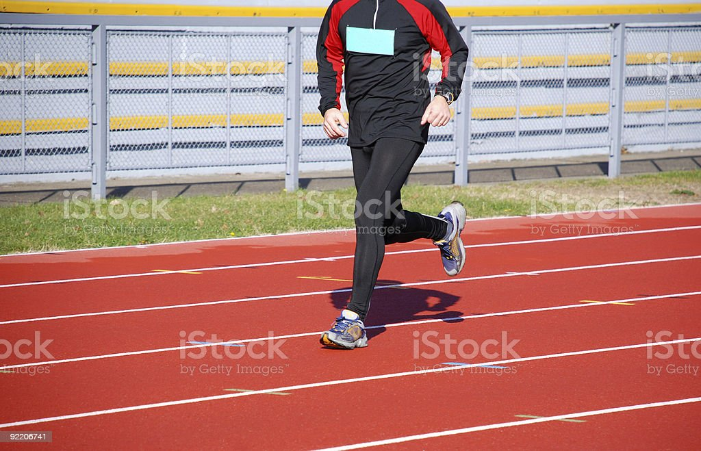 runner is running on the track royalty-free stock photo