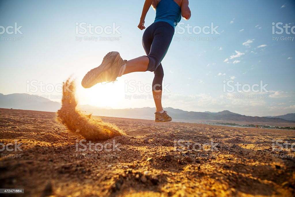 Runner jogging in the desert sun stock photo