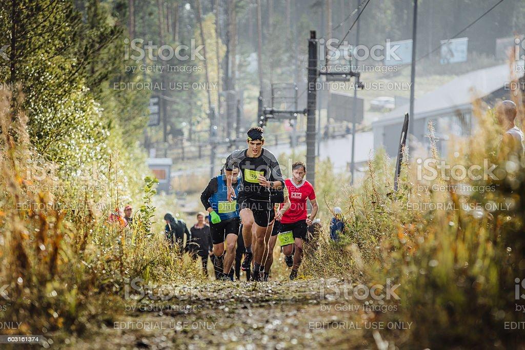 runner leader runs ahead group of athletes marathoners royalty-free 스톡 사진