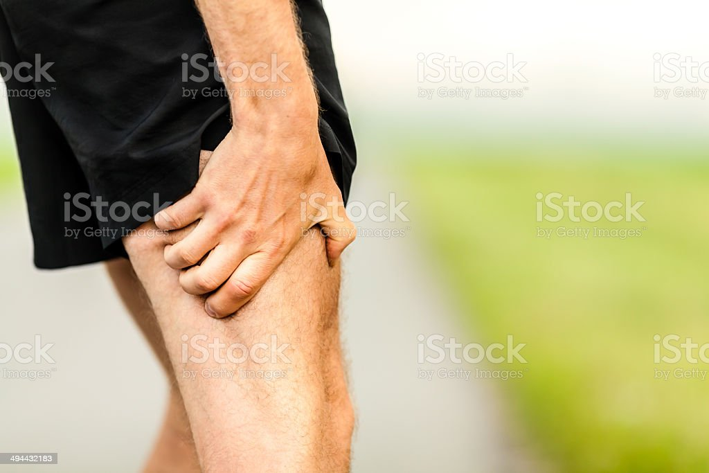 Runner leg pain injury stock photo