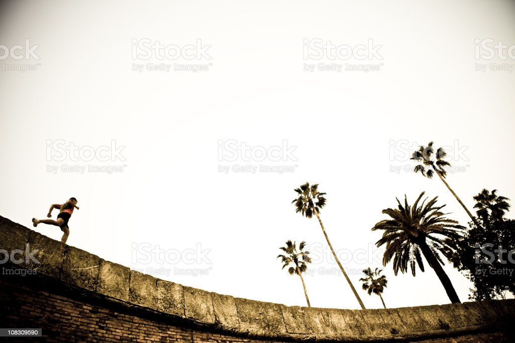 Runner on a curved wall royalty-free stock photo