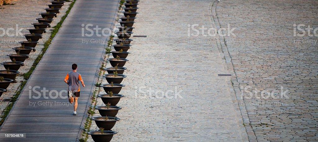 Runner on a long boardwalk royalty-free stock photo