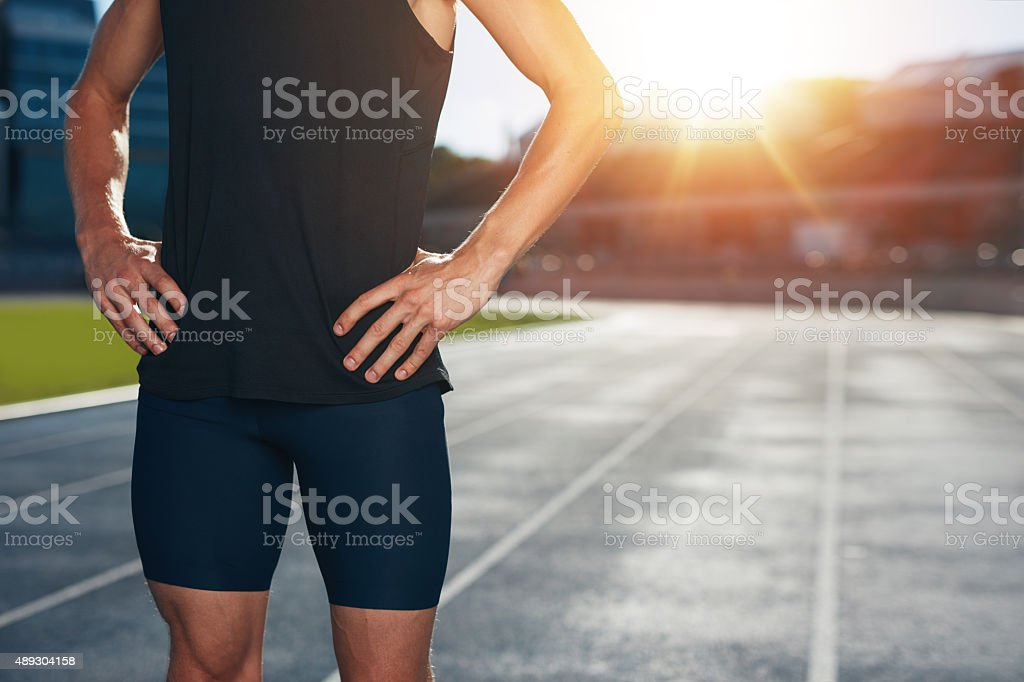 Runner on athletics running track stock photo