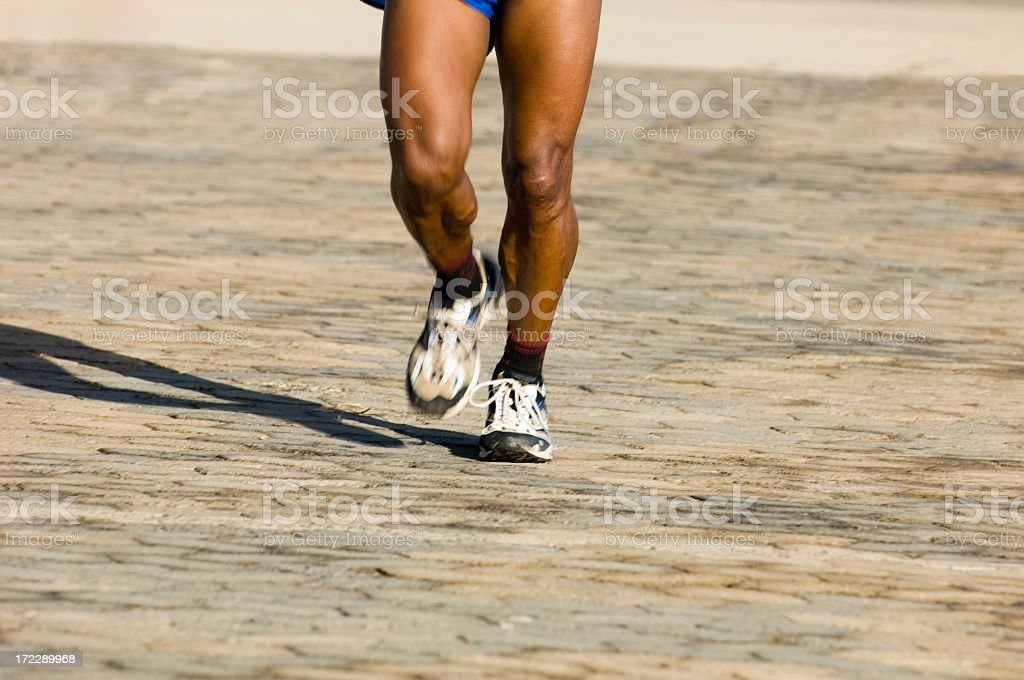 Runner on paved road stock photo