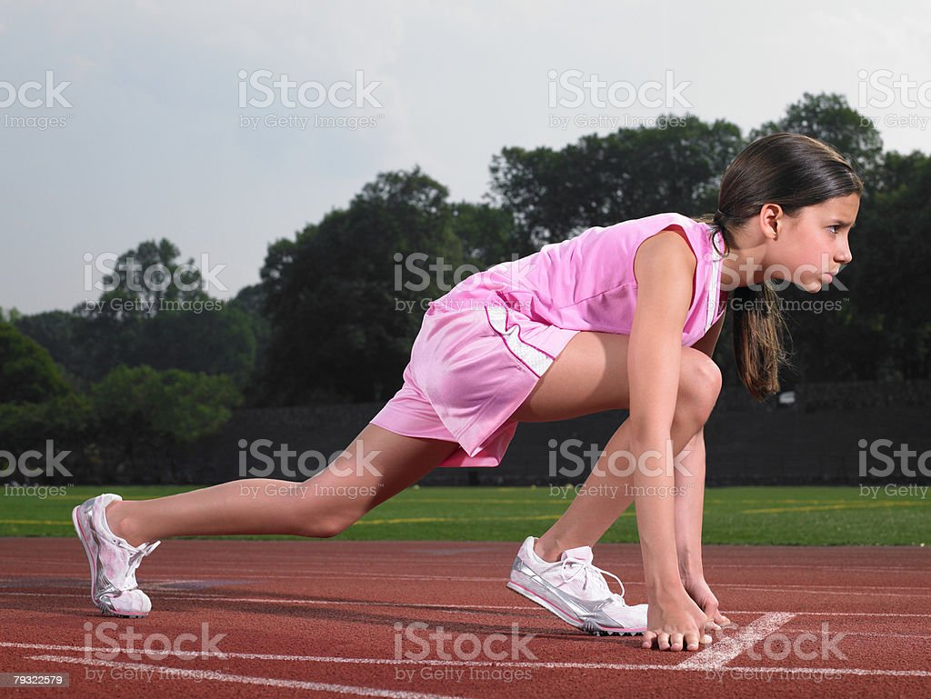 A runner on the starting line stock photo