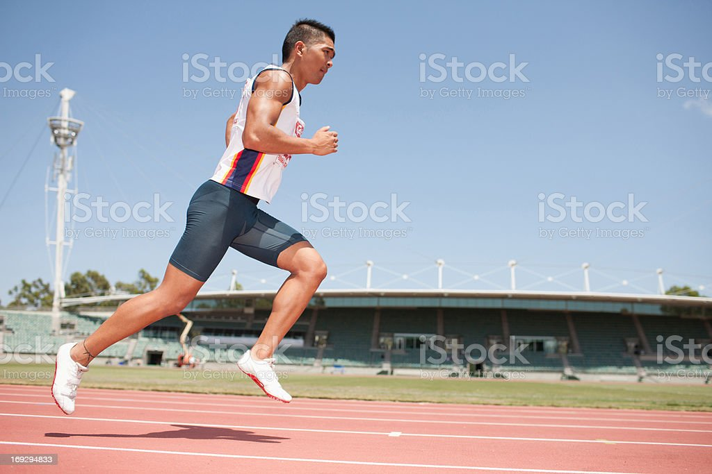 Runner on track stock photo