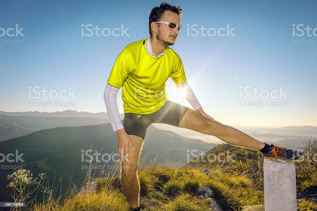 Runner prepares for a run , stretching, morning, Sabotin, Primorska,Slovenia stock photo