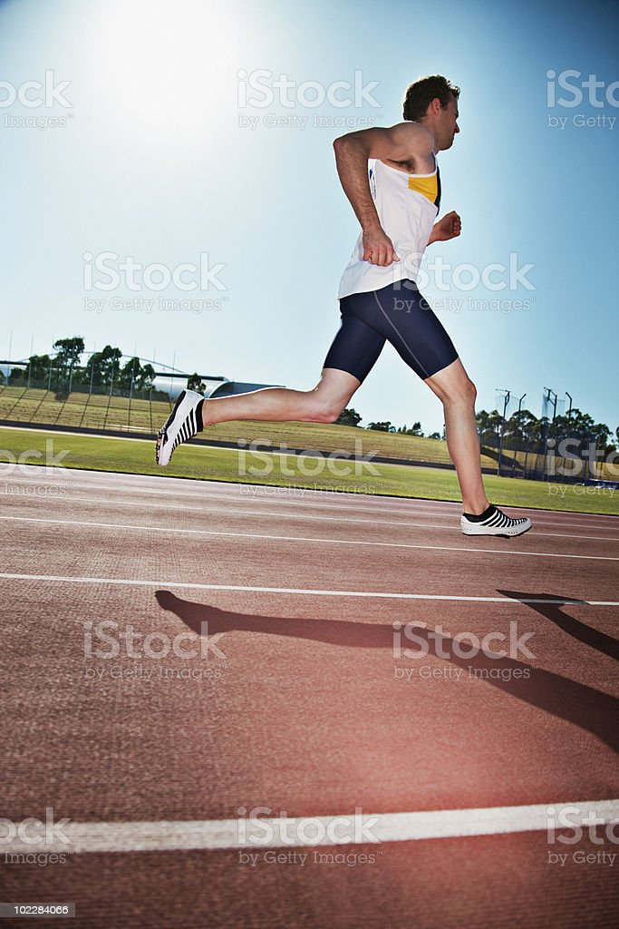 Runner running on track royalty-free stock photo