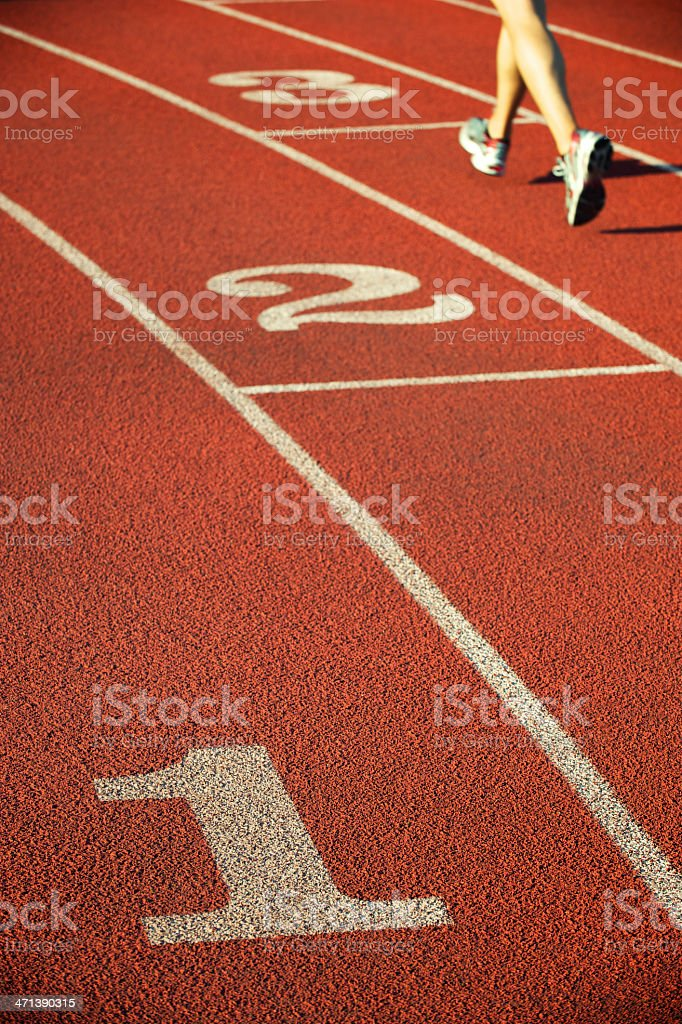 Runner Runs Along Bright Textured Track royalty-free stock photo